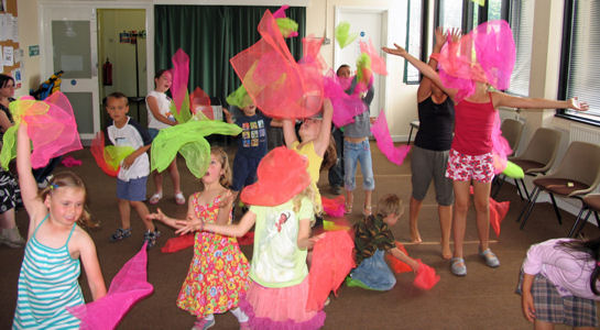 Juggling scarves at a Circus Skills party.